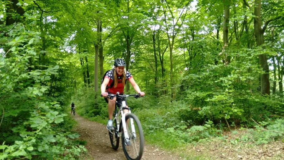 image of woman riding mountain bike