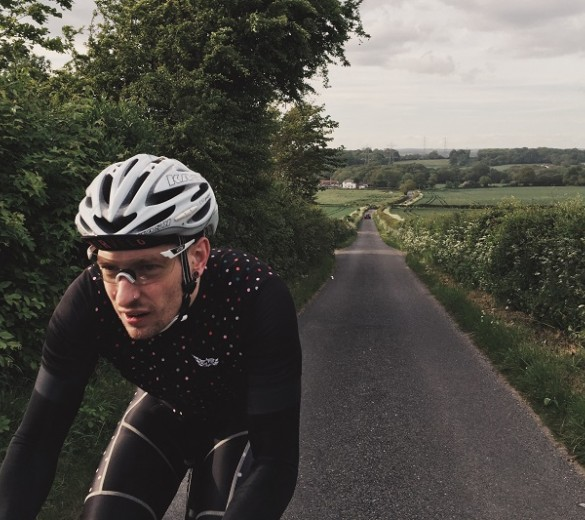 Image of Chris Wright cycling on country road