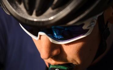 rider taking hydration gel