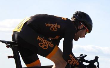 image of Tim riding his road bike and pushing hard