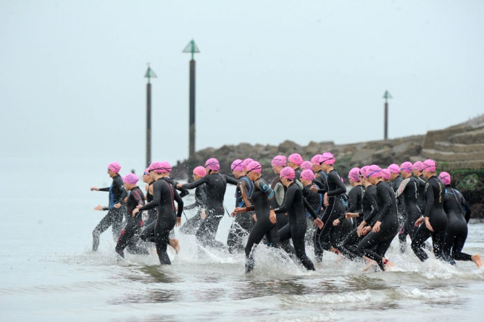 Swimmers sprinting into the sea