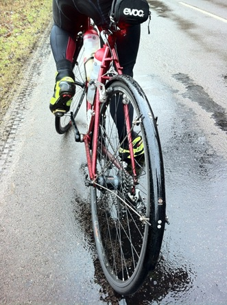 Rear image of a bike on a wet road